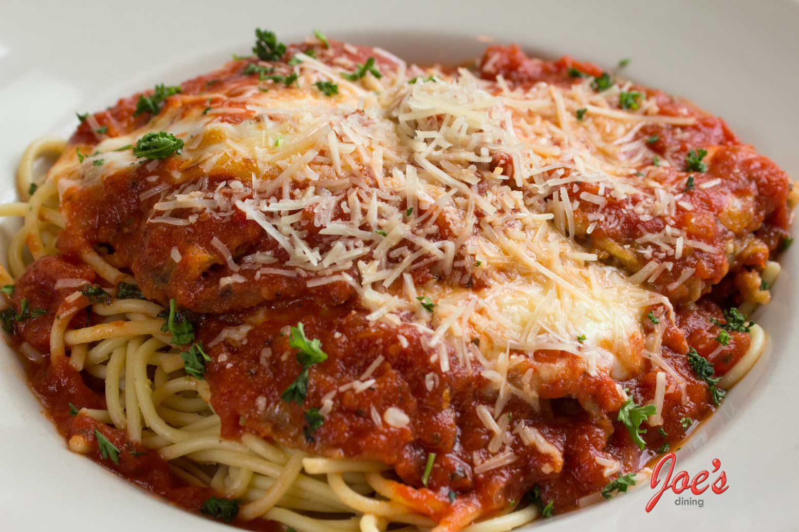 fried, than layered with fresh mozzarella and marinara sauce, baked ...